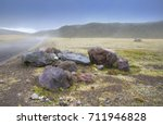 old rocks next to the dirt road ... | Shutterstock . vector #711946828