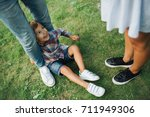 legs of man woman and child on... | Shutterstock . vector #711949306