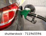car refueling at the petrol... | Shutterstock . vector #711965596