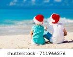 kids in red santa hats having... | Shutterstock . vector #711966376