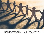 human chain paper with light... | Shutterstock . vector #711970915