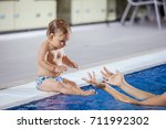young woman catching little son ... | Shutterstock . vector #711992302