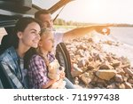 happy family on a road trip in... | Shutterstock . vector #711997438