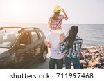 happy family standing near a... | Shutterstock . vector #711997468