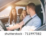happy family on a road trip in... | Shutterstock . vector #711997582