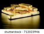 close up pure gold bar ingot... | Shutterstock . vector #712023946