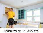 installation of kitchen. worker ... | Shutterstock . vector #712029595