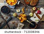 forest harvest  blueberry ...   Shutterstock . vector #712038346