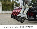row scooters for rental | Shutterstock . vector #712137295