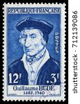 Small photo of Paris, France - June 9, 1956: Guillaume Budé (1467-1540), Famous French scholar in 16th century. Stamp issued by French Post in 1956.