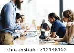 group of business people in a... | Shutterstock . vector #712148152