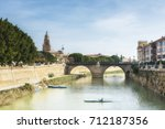kayaks on segura river and old... | Shutterstock . vector #712187356