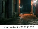 ancient town street at night | Shutterstock . vector #712191595
