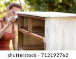 woman is painting an old... | Shutterstock . vector #712192762