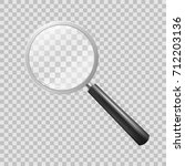 magnifying glass on checkered... | Shutterstock .eps vector #712203136