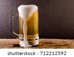 beer in mug on wooden table... | Shutterstock . vector #712212592