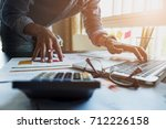 accountants work analyzing... | Shutterstock . vector #712226158