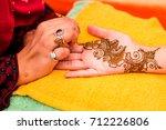 mehndi artist carefully...   Shutterstock . vector #712226806