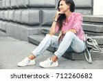 fashion model wearing ripped... | Shutterstock . vector #712260682