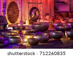 singing bowls lit by candlelight | Shutterstock . vector #712260835