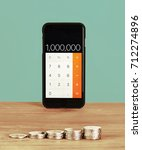mobile phone used as calculator ... | Shutterstock . vector #712274896