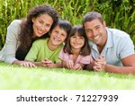 happy family lying down in the... | Shutterstock . vector #71227939