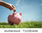 child hand inserting coin and... | Shutterstock . vector #712281646