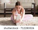 flexible fitness girl... | Shutterstock . vector #712283326