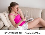 tired of glasses young woman... | Shutterstock . vector #712286962