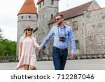 travel concept   two tourists... | Shutterstock . vector #712287046