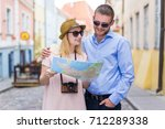 young couple of smiling... | Shutterstock . vector #712289338
