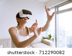 Young Excited Woman Wearing Vr...