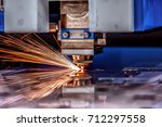 cnc laser cutting of metal ... | Shutterstock . vector #712297558