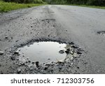 gravel road in a bad shape.... | Shutterstock . vector #712303756