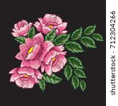 dog roses embroidery on black... | Shutterstock .eps vector #712304266