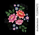 dog roses and blue flowers... | Shutterstock .eps vector #712304272