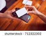 closeup shot of female hand... | Shutterstock . vector #712322302