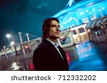 young stylish guy on the... | Shutterstock . vector #712332202