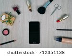 top view of cosmetics and make... | Shutterstock . vector #712351138