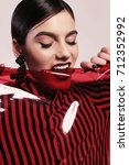 fashion studio photo of...   Shutterstock . vector #712352992
