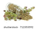 glass bottle with thyme on... | Shutterstock . vector #712353592