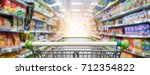 supermarket aisle with empty...   Shutterstock . vector #712354822