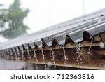 raining on roof house and... | Shutterstock . vector #712363816