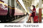 woman sitting on suitcase red... | Shutterstock . vector #712372615