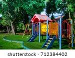 children playground on yard... | Shutterstock . vector #712384402