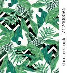 seamless tropical leaves... | Shutterstock .eps vector #712400065