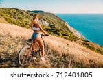 mountain biking  woman with... | Shutterstock . vector #712401805