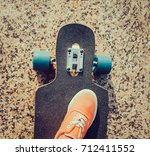 female foot wearing in pink... | Shutterstock . vector #712411552