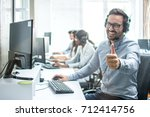 cheerful male customer service... | Shutterstock . vector #712414756