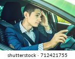the upset driver man in the car....   Shutterstock . vector #712421755